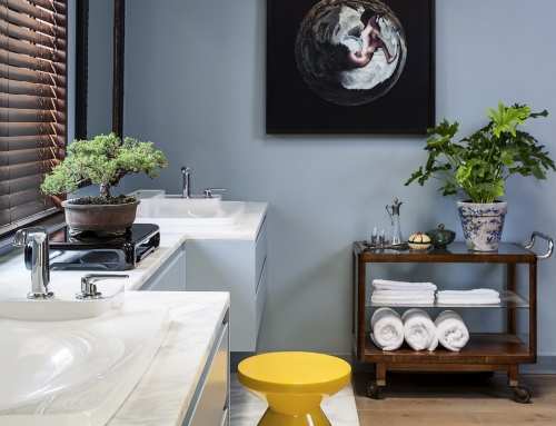 MASTER BATHROOM VANITY – An open plan bathroom designed in deconstruction of use. Marble clad  bathroom vanities defined by existing windows. The yellow stool and deco trolley offset by work from artist Minnette Vari.